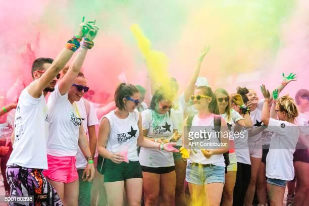 People take part in a Colour Run in Ljubljana on June 23 2017 / AFP PHOTO / Jure Makovec