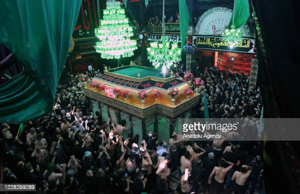 People take part in a commemoration ceremony for the martyrdom of Islamic Prophet Mohammad's grandson Hussain ibn Ali and his companies, killed in...