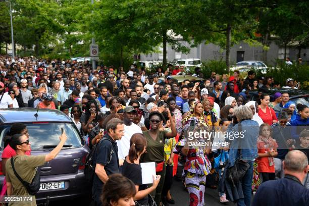 People take part in a commemorative march starting at the site where a man who was shot dead by an officer during a police check in the Breil...