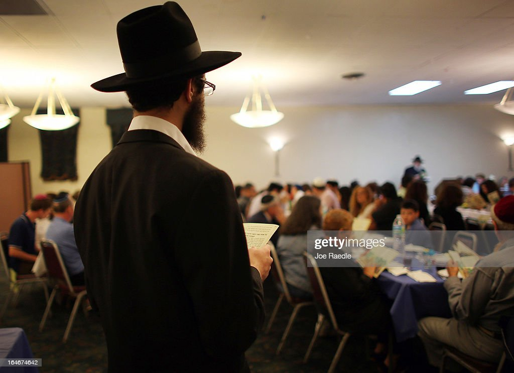 People take part in a community Passover Seder at Beth Israel synagogue on March 25, 2013 in Miami Beach, Florida. The community Passover Seder that served around 150 people has been held for the past 30 years and is welcome to anyone in the community that wants to commemorate the emancipation of the Israelites from slavery in ancient Egypt.
