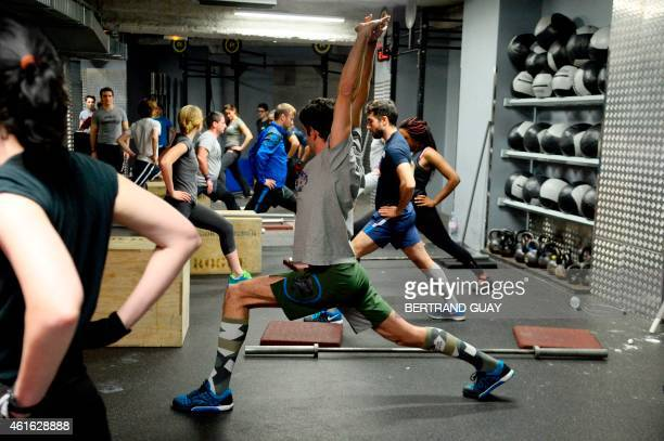 People take part in a crossfit training in a gym in Paris on January 16 2015 AFP PHOTO / BERTRAND GUAY