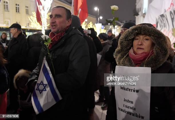 People take part in a demonstration against a controversial new Polish bill regarding the Holocaust and the definition of Nazi death camps on...