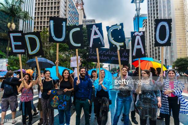 People take part in a demonstration against education cuts and pension reform in Sao Paulo Brazil on Wednesday May 15 2019 Tens of thousands of...