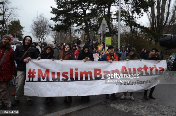 People take part in a demonstration against islamophobia and racism during the International Day of Action Against Racism, in Vienna, Austria on...