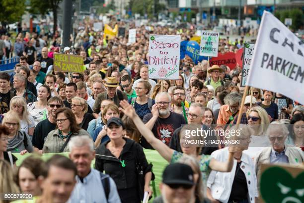 People take part in a demonstration against massive logging in Bialowieza primeval forest in Warsaw Poland on June 24 2017 Polish Environment...