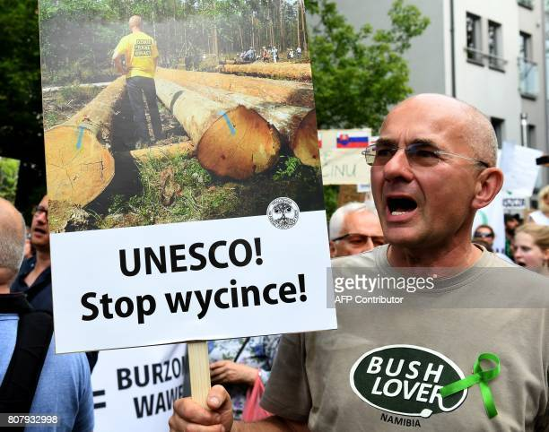 People take part in a demonstration against massive logging in Bialowieza primeval forest in Krakow Poland on July 4 2017 in front of congress hall...