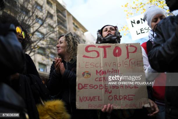 People take part in a demonstration against slavery in Libya on November 25 2017 in Marseille southern France / AFP PHOTO / ANNECHRISTINE POUJOULAT