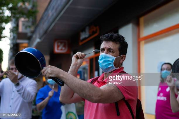 People take part in a demonstration against the crisis management of the COVID-19 of the Pedro Sanchez government in Madrid, Spain, on May 22, 2020.