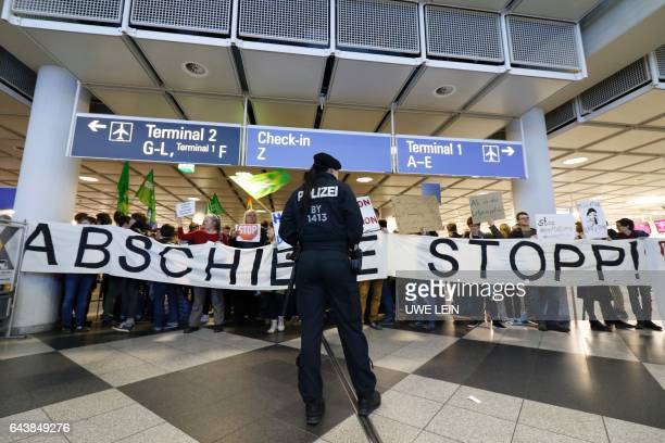 People take part in a demonstration against the deportation of some 50 Afghan refugees from Munich airport southern Germany on February 22 2017 / AFP...