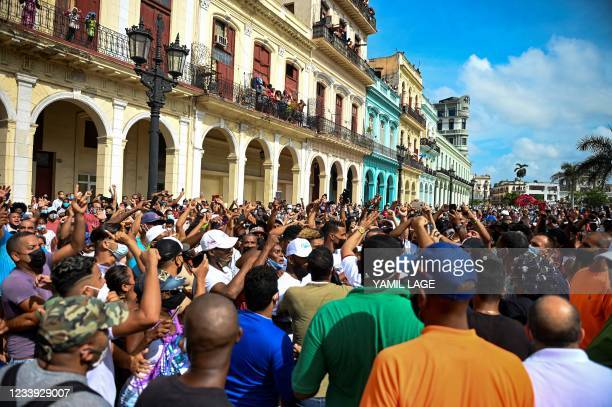 People take part in a demonstration against the government of Cuban President Miguel Diaz-Canel in Havana, on July 11, 2021. - Thousands of Cubans...