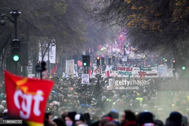 TOPSHOT People take part in a demonstration against the pension overhauls in Paris on December 5 2019 as part of a nationwide strike Trains cancelled...