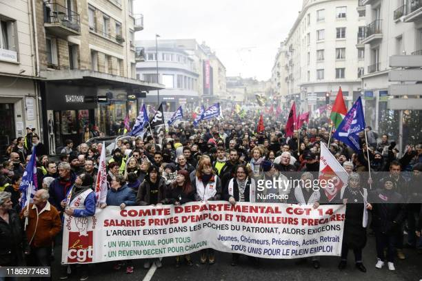 People take part in a demonstration against the pension overhauls in Caen France on December 7 2019 as part of a nationwide strike Trains cancelled...