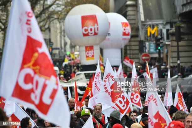 People take part in a demonstration against unemployment and precarious work on December 2 2017 in Paris called by associations and unions fighting...