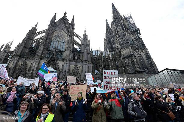 People take part in a demonstration against violence against women in front of the cathedral in Cologne western Germany on January 9 2015 where...
