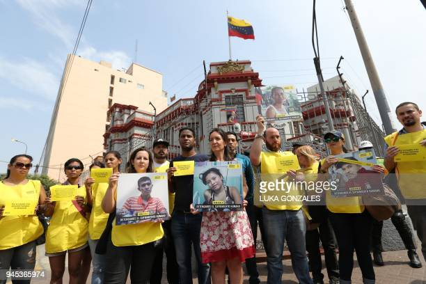 People take part in a demonstration called by Amnesty International in front of the Venezuelan embassy in Lima to demand the respect for human rights...
