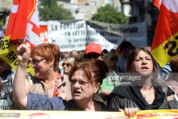 People take part in a demonstration called by seven French civil servant unions against austerity measures and for salary adjustments on May 15 2014...