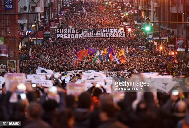People take part in a demonstration called by the citizens' network Sare protesting against dispersion of Basque prisoners in the northern Spanish...