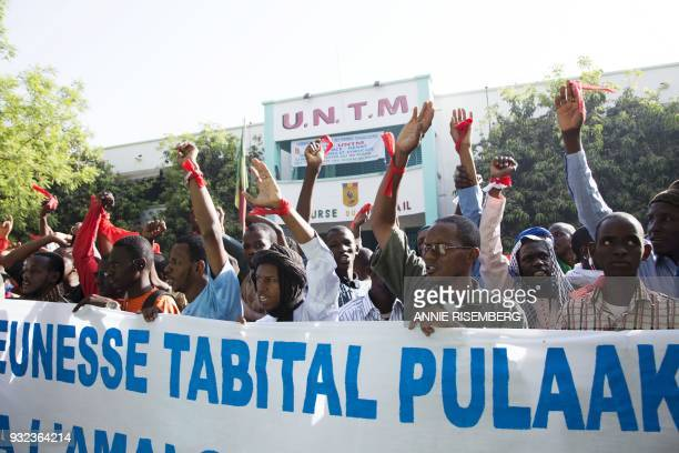 People take part in a demonstration in Bamako on March 15 2018 organized by the Jeunesse Tabital PulaakuMali the youth chapter of an organization...