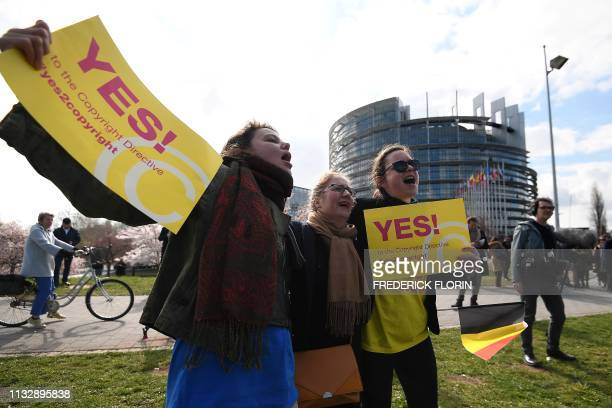 People take part in a demonstration in favour of the new copyright directive ahead of the vote on copyright in the Digital Single Market at the...