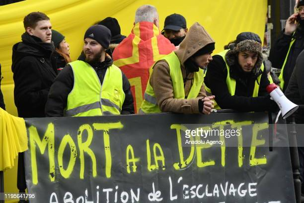 People take part in a demonstration, including members of trade unions, to protest against the pension reform plan, in Paris, France as the general...