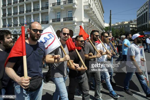 People take part in a demonstration marking a 24hour general strike against against planned austerity measures on May 30 2018 in Athens Greece The...