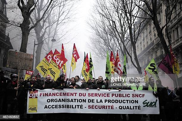 People take part in a demonstration organized by CGT and Sud Rail unions to protest against the reform of the railway system in Paris on January 29...