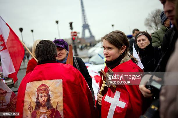 People take part in a demonstration responding to a call by fundamentalist Christians group Civitas Institute to denounce christianophobia and...