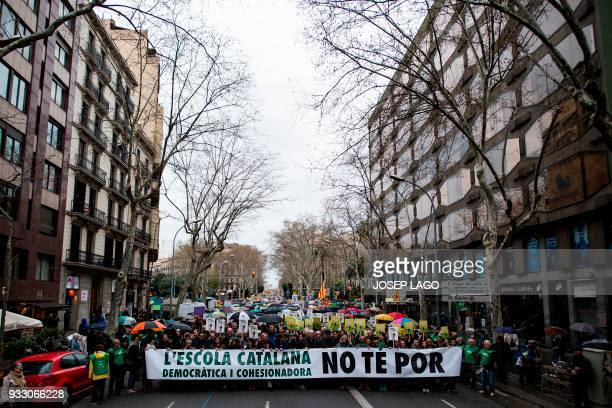 People take part in a demonstration titled 'The democratic and cohesive school is not afraid' organized by Catalan educational groups 'SOM ESCOLA' to...