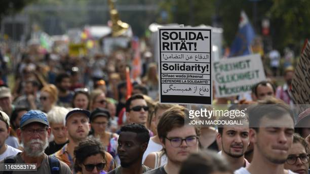 """People take part in a demonstration titled """"Unteilbar"""" against exclusion on August 24, 2019 in Dresden, eastern Germany. - Thousands of civil society..."""