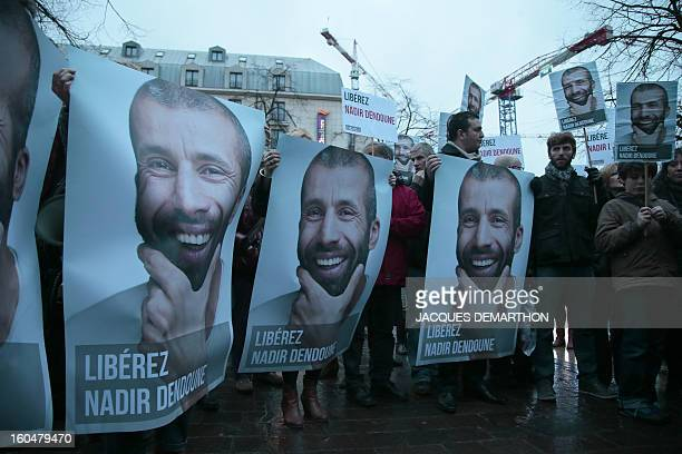 People take part in a demonstration to free French journalist Nadir Dendoune arrested and detained in Iraq since January 23 in Paris on February 1...