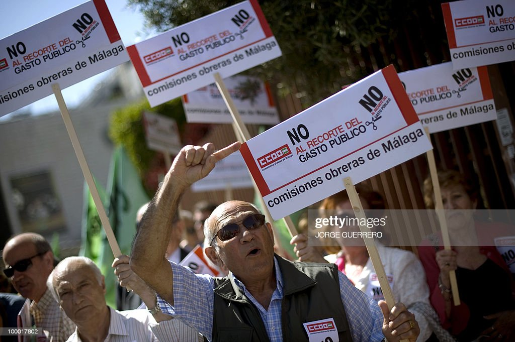 People take part in a demonstration to protest about cuts announced by the Government, in Malaga on May 20, 2010. Spain's socialist government, which is pushing through an unpopular austerity package, plans a new tax for those who possess more than one million euros of assets, a news report said Thursday.