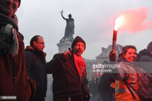 People take part in a demonstration to protest against French government's string of reforms on March 22 2018 at place de la Republique in Paris...