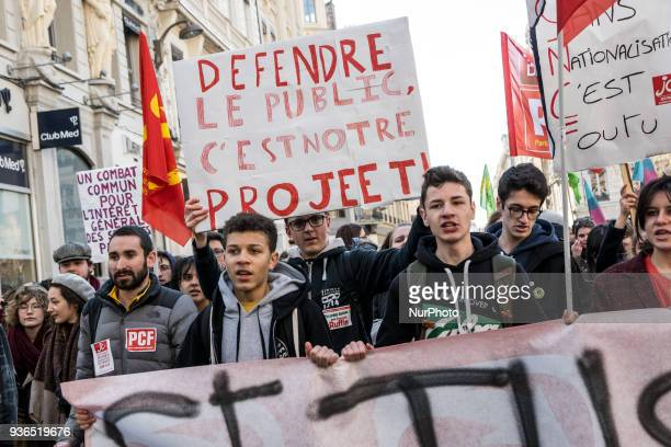 People take part in a demonstration to protest against French government's string of reforms on March 22 2018 in Lyon southeasthern France Seven...