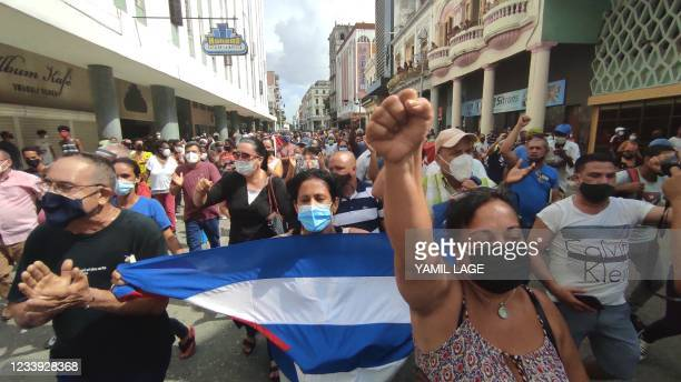 People take part in a demonstration to support the government of the Cuban President Miguel Diaz-Canel in Havana, on July 11, 2021. - Thousands of...