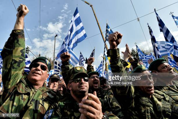 People take part in a demonstration to urge the government not to compromise in the festering name row with neighbouring Macedonia at the Syntagma...