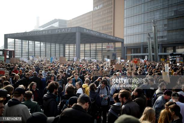 People take part in a demonstration under the slogan Save The Internet against the planned overhaul of European Union's online copyright law on March...