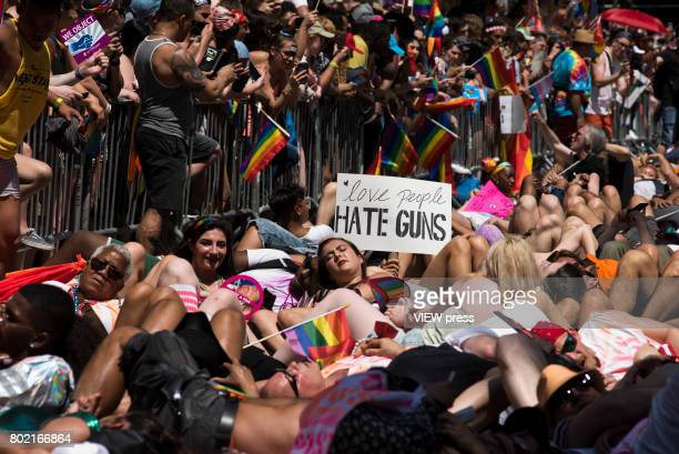 People take part in a 'die in' during the 2017 New York City Pride March on June 25 2017 in New York City 'n