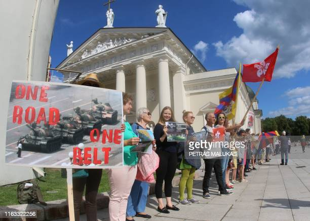"""People take part in a human chain protest in support of the Hong Kong Way, a recreation of a pro-democracy """"Baltic Way"""" protest against Soviet rule..."""