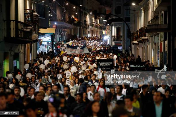 People take part in a march against violence in Quito on April 19 called by colleagues friends and relatives of journalists Paul Rivas Javier Ortega...