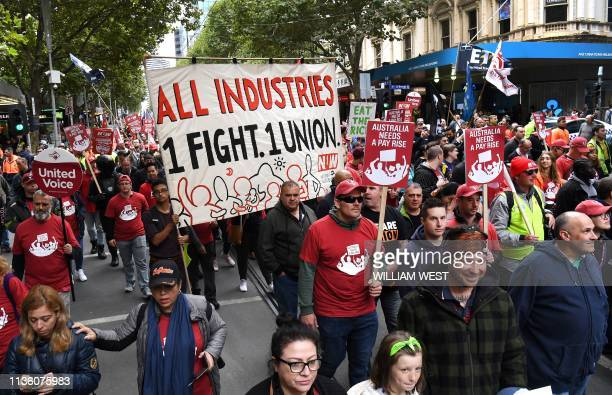 People take part in a march for better work conditions and higher wages in Australia in Melbourne on April 10 2019 Tens of thousands marched for...