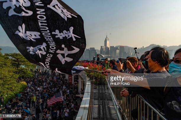 People take part in a march from Tsim Sha Tsui to Hung Hom in Hong Kong on December 1, 2019. - Police fired tear gas and pepper spray in Hong Kong on...