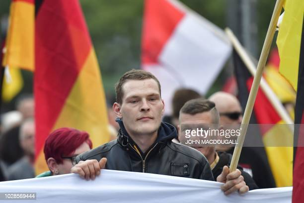 "People take part in a march organised by the right-wing populist ""Pro Chemnitz"" movement, on September 7, 2018 in Chemnitz, the flashpoint eastern..."