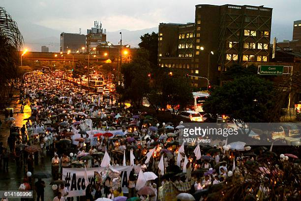 People take part in a march supporting the peace process on October 7, 2016 in Medellin, Colombia.
