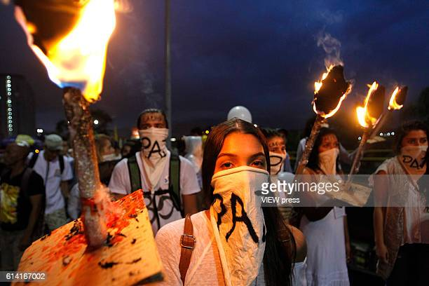People take part in a march supporting the peace process on October 7 2016 in Medellin Colombia