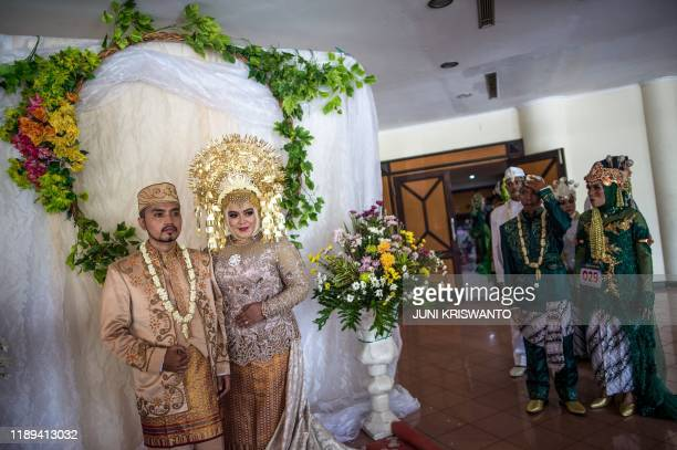 TOPSHOT People take part in a mass wedding for sixty couples sponsored by local government social services in Surabaya on December 18 2019