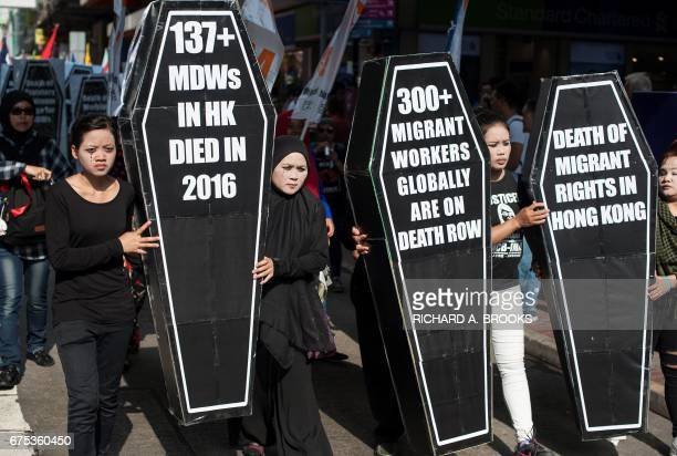 People take part in a May Day protest march in the streets of Hong Kong on May 1 2017 A few thousand people marched on Hong Kong island to mark...