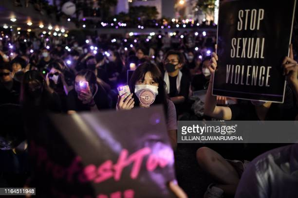 TOPSHOT People take part in a #MeToo rally in Hong Kong on August 28 to protest alleged sexual assaults by police against antigovernment female...