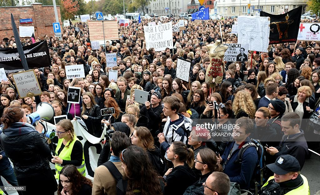 People take part in a nationwide strike and demonstration to protest against a legislative proposal for a total ban of abortion on October 3, 2016 in Warsaw. Thousands of women dressed in black protested across Poland in the 'Women strike' campaign against a proposed near-total abortion ban in the devoutly Catholic country where legislation is already among the most restrictive in Europe. / AFP / JANEK