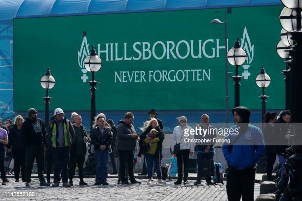 People take part in a one minute silence outside Liverpool's Saint George's Hall as people pay their respects on the 30th anniversary of the...