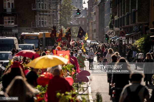 People take part in a parade in Copenhagen, Denmark, on September 22 to mark the 50th anniversary of Freetown Christiania from the free town to the...